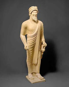 Limestone statue of a bearded man with votive offerings. Cypriot, (c. 475–450 BC)