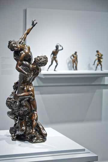 Antonio Susini's 'Rape of a Sabine' in the foreground, and in the background, Riccio's 'Strigil Bearer' and other early Italian bronzes from the collection of Mr. and Mrs. J. Tomilson Hill.