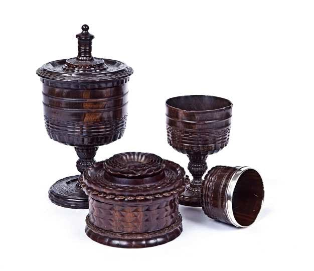 A rare collection of Lignum Vitae ornamentally turned objects by 'The Tudor Court Turner and his inheritor', England (late 16th and early 17th century).