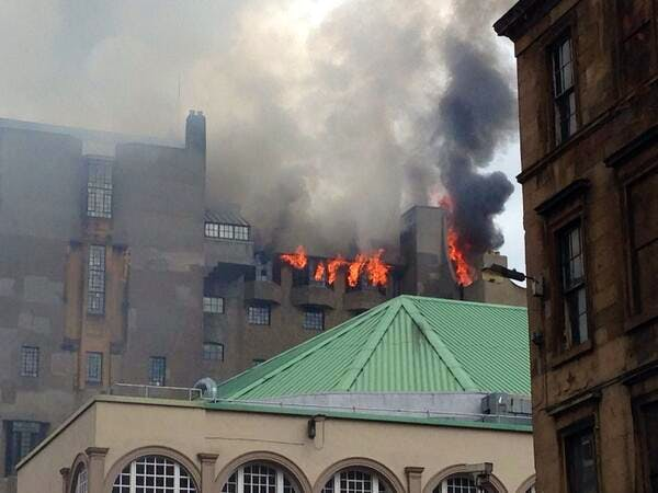 Photos show flames and smoke billowing from the windows