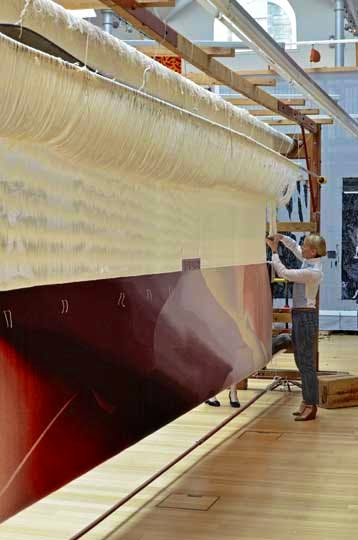 Alison Watt, cutting the 'Butterfly' tapestry from the loom. Dovecot Studios, 19 May 2014.