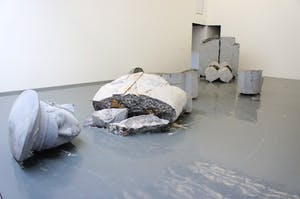 Installation view showing the broken sculpture of an officer by Zhao Zhao (b. 1982), Chambers Fine Art, 2011