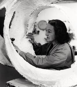 Barbara Hepworth at work on the plaster for Oval Form (Trezion) in the Palais de Danse studio, St Ives (1963)