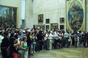 Crowds gather around the Mona Lisa in the Louvre.