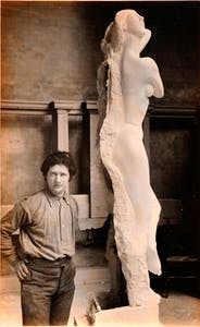 Photograph of Jacob Epstein in studio with plaster model of 'Dancing Girl'; commission for the British Medical Association Building, Strand and Agar Street, London (c. 1907)