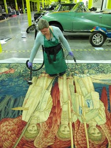 Conservator Jane Thompson-Webb prepares a panel from William Morris' Quest for the Holy Grail Tapestries (1895–1900).