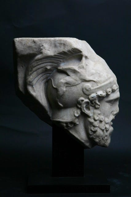 Roman relief fragment depicting the head of Mars, 2nd century AD. Courtesy of Rupert Wace Ancient Art. On show as part of 'CLASSICICITY' at Breese Little gallery