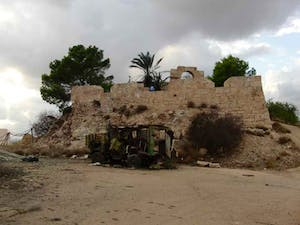 One of six vehicles destroyed by a NATO strike outside the relatively untouched Roman fort at Ras Almargeb, Libya in 2011.