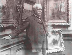 Photograph of Paul Durand-Ruel in his gallery (c. 1910), taken by Dornac