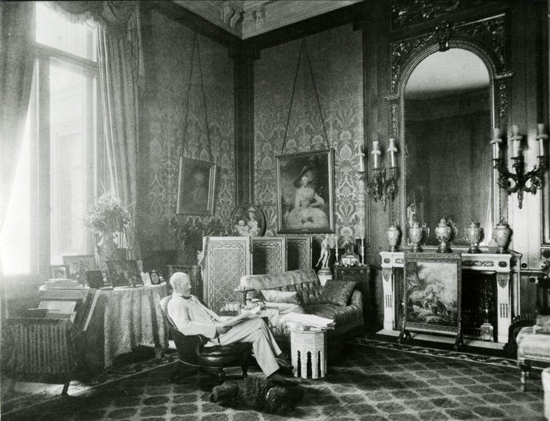 Ferdinand de Rothschild (1839–98) with the dog Poupon in The Baron's Room at Waddesdon Manor, Buckinghamshire.