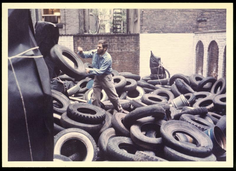 Allan Kaprow installing the first version of 'Yard', in the sculpture garden of Martha Jackson Gallery in New York, 1961.