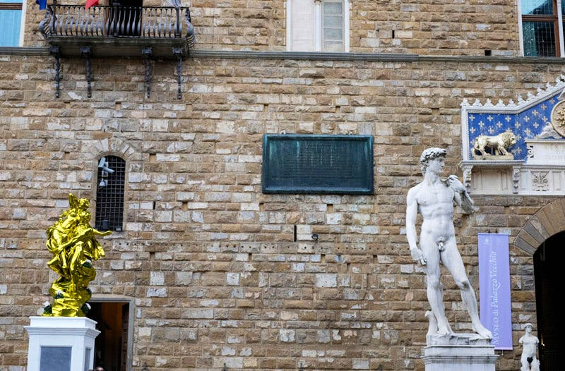 Koons's 'Pluto and Proserpina' joins Michelangelo's 'David' outside the Palazzo Vecchio in Florence.