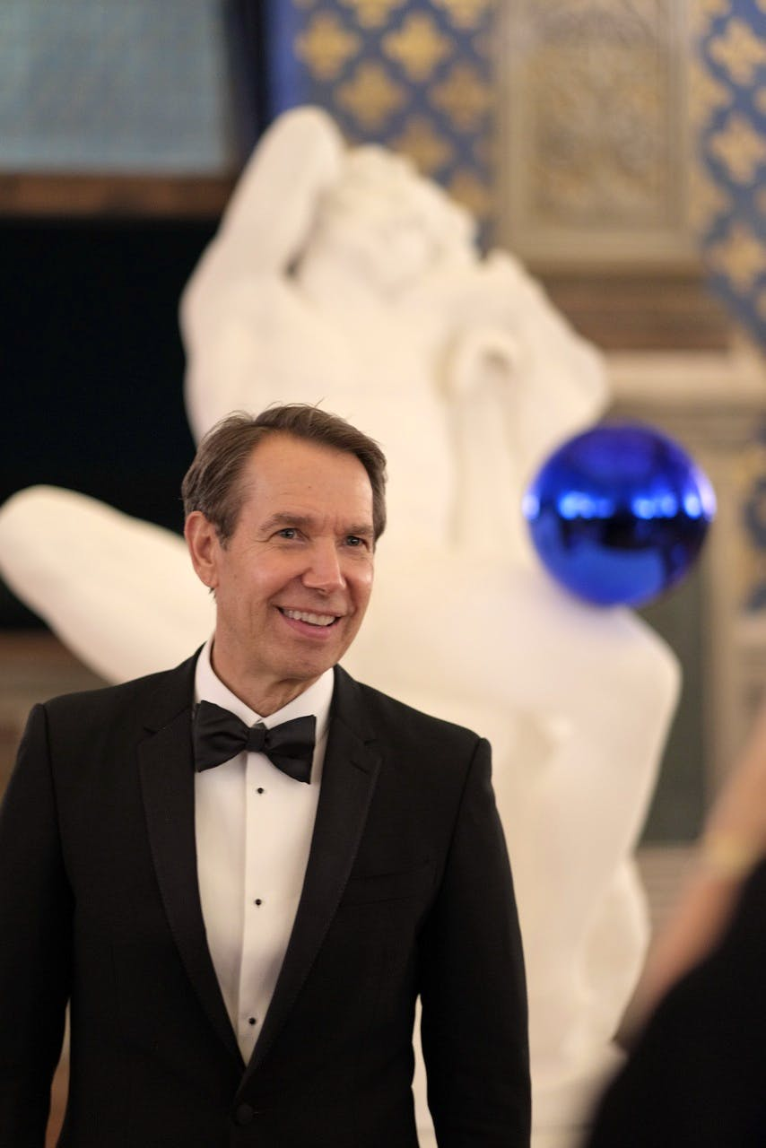 Jeff Koons with 'Gazing Ball: Barberini Faun' (2013).