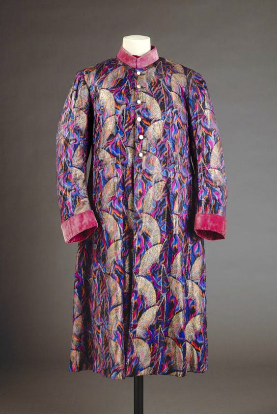 Dinner jacket/coat, (1930s), Indian, probably Calcutta, French silk woven with metal thread, edged with velvet.