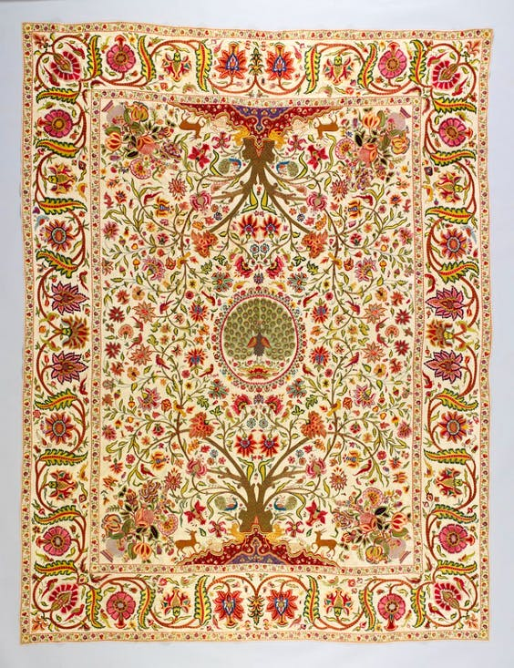 Palampore (bed cover) (1710–50), Deccan, India. Cotton embroidered with silk and metal-wrapped threads.