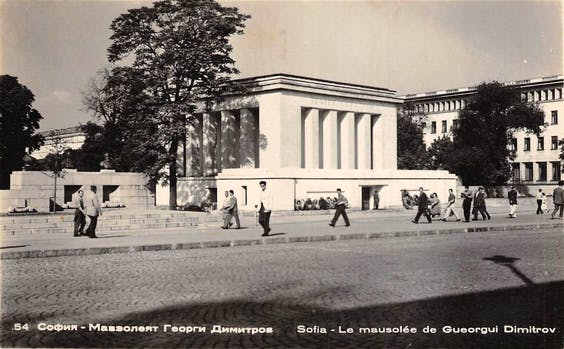 A postcard stamp marked 1957, showing the Georgi Dimitrov mausoleum in Sofia. The building was designed by Georgi Ovcharov in 1949 and demolished in 1999