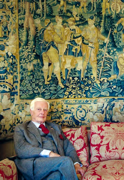 Baron van Dedem in his drawing room in 2010. Behind him is a late 16th-century Flemish tapestry.