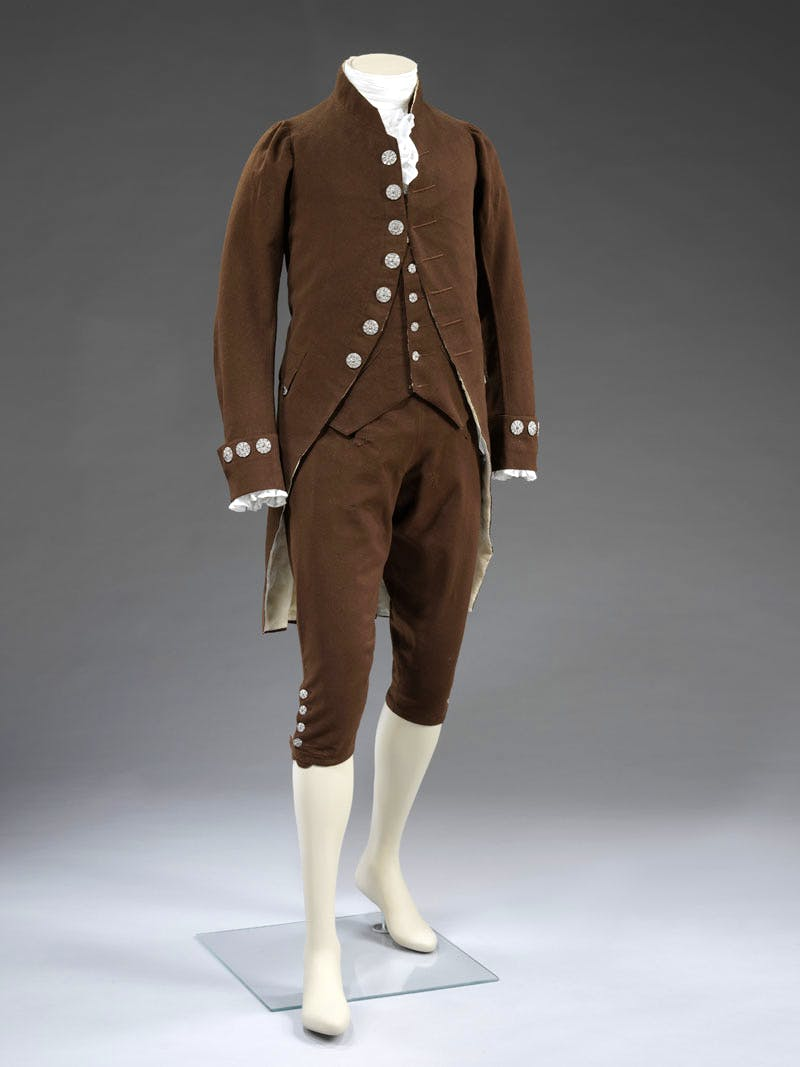 Coat, waistcoat, and breeches liked with silk and linen, with cut steel buttons, c. 1790, France
