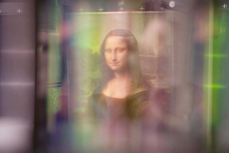 The Mona Lisa, as viewed through Pascal Cotte's multispectral imaging camera which takes photos at 13 different light wavelengths, and uses complex algorithms to analyse and uncover hidden details in paintings at layers and depths never possible before.