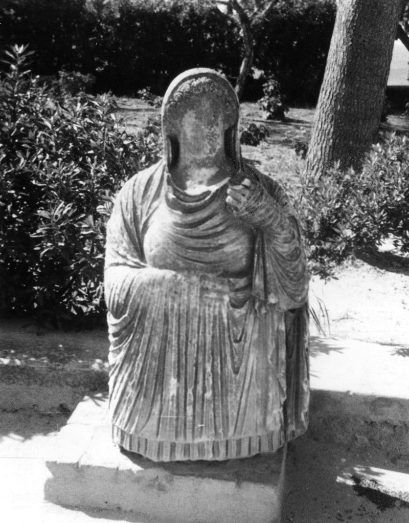 Faceless statue of Persephone rising from the underworld. This figure once adorned a tomb at Cyrene (c. 350-150 BC)