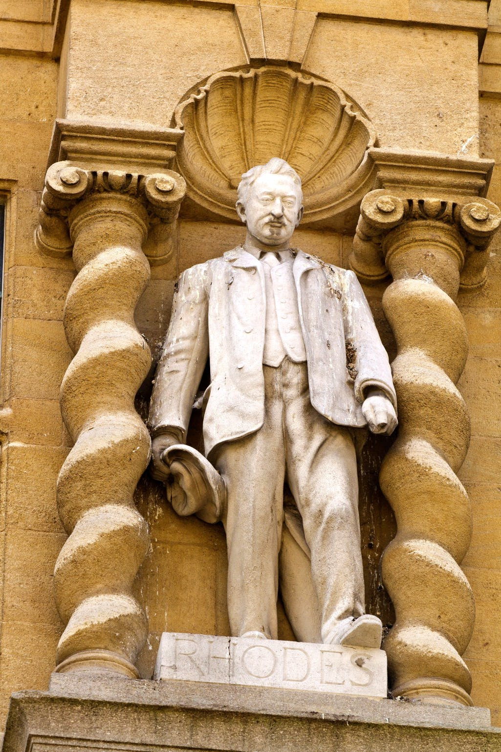 Statue of Cecil Rhodes on the façade of Oriel College, Oxford on the High Street, built in 1911