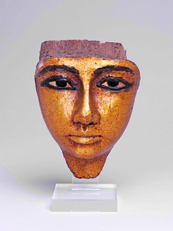 Face from coffin, with eyes and eyebrows inlaid, gilded (1186-1069 BC), Twentieth Dynasty, New Kingdom, Egyptian