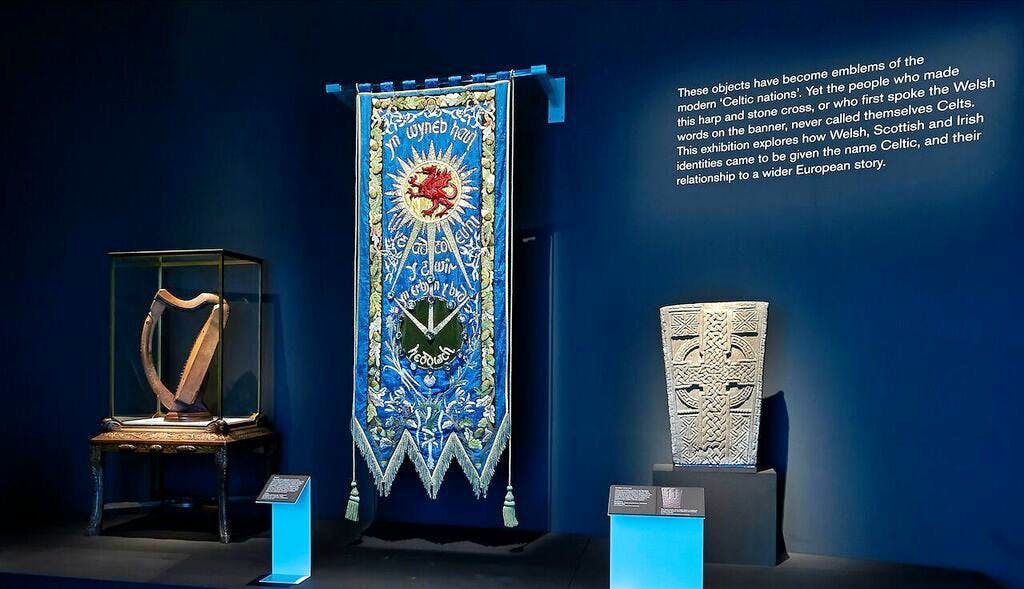 Queen Mary's harp (left) displayed in the opening room of 'Celts: Art and Identity'