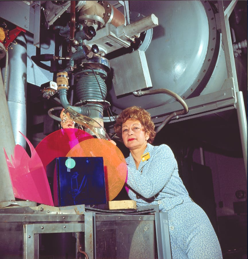 Alyce Simon (1925–2011) with particle accelarator at Radiation Dynamics, Inc. NY, 1975