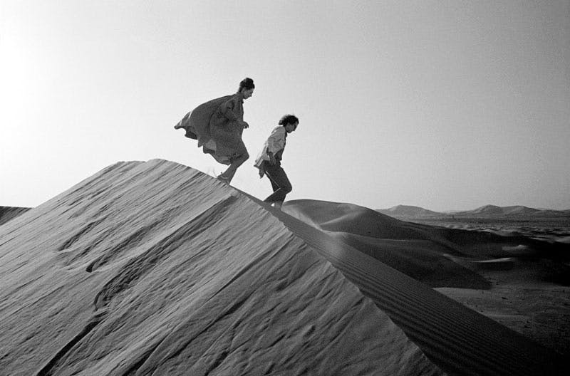 Christo and Jeanne-Claude looking for a possible site for The Mastaba, February 1982