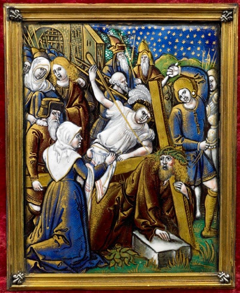 Simon of Cyrene helps Jesus carry the cross.