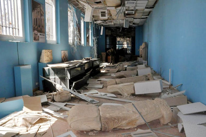 A view shows damaged artefacts inside the museum of the historic city of Palmyra, after forces loyal to Syria's President Bashar al-Assad recaptured the city, in Homs Governorate in this handout picture provided by SANA on March 27, 2016.
