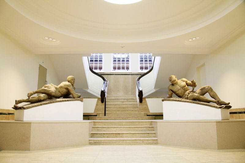 The Bethlem Museum of the Mind, with statues Raving and Melancholy Madness by Caius Gabriel Cibber.