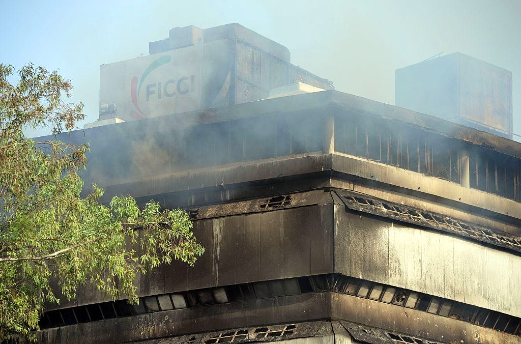 Smoke rises from The National Museum of Natural History in New Delhi on April 26, 2016, after an early morning fire was controlled. No casualties were reported, but the entire collection may have been lost.