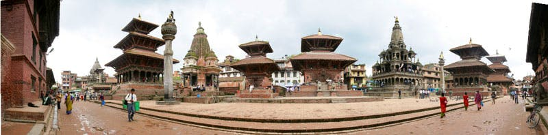 Pre-earthquake panoramic view of Patan Darbar (Royal) Square as seen from the Patan Palace. (The palace west facade is visible at the far ends of the photo).