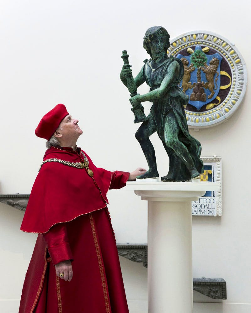 Actor Paul Jesson as Cardinal Wolsey, with one of Wolsey's angels at the V&A
