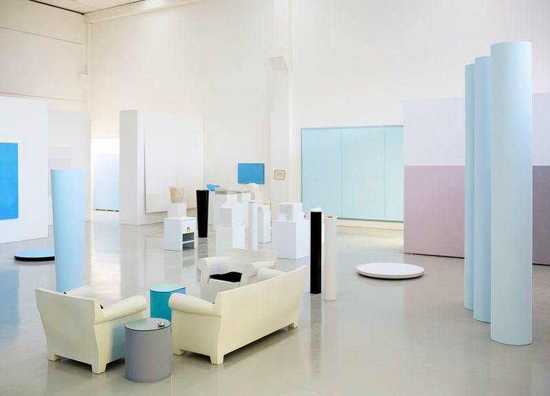 View of Spalletti's studio, which includes a selection of columns placed alongside other sculptural elements in pastel hues