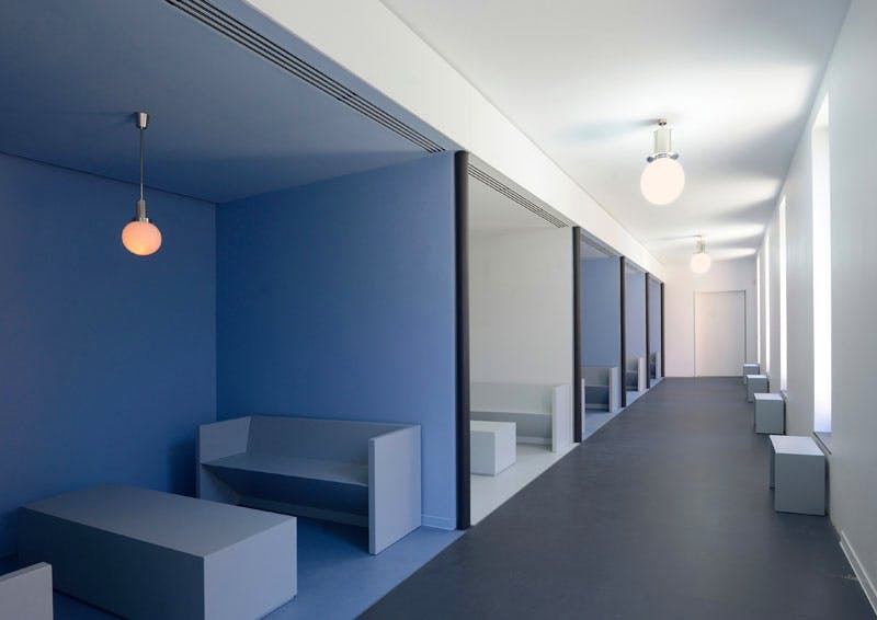The morgue in a building adjacent to the chapel at Città Sant'Angelo, designed by Spalletti and his wife Patrizia Leonelli, and showing a series of five identical rooms off an open corridor.