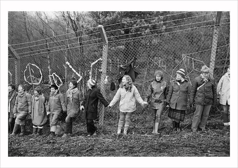 'Embrace the Base': 30,000 women link hands, completely surrounding the nine mile perimeter fence at RAF/USAF Greenham Common, Berkshire