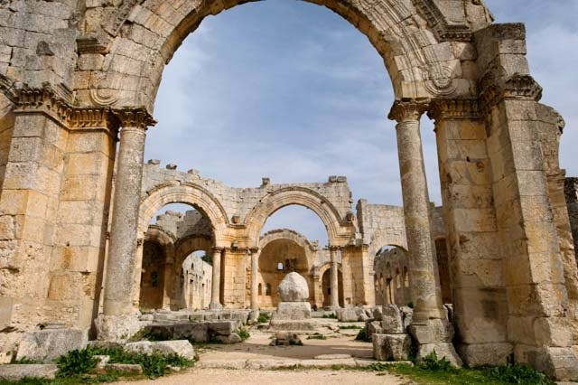 The courtyard of the Church of St Simeon looking east through the courtyard towards the east basilica. The remaining stub of the saint's column in the middle of the courtyard has been dislodged by the blast.