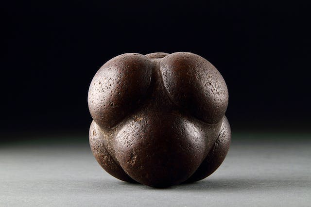 Stone sphere or ball divided into six sections (3000–2500 BC), early Scottish or Pictish.