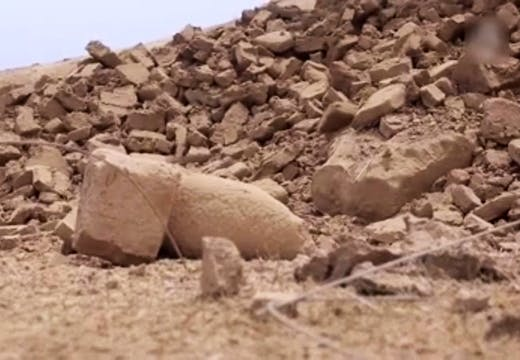 Screenshot from ISIS video showing the destroyed 'mermen' statues of the seven sages at the Fish Gate, Temple of Nabu, Nimrud, Iraq