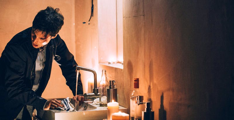Remainder (2016), Omer Fast. Tom (Tom Sturridge) peers round model of Madlyn Mansions
