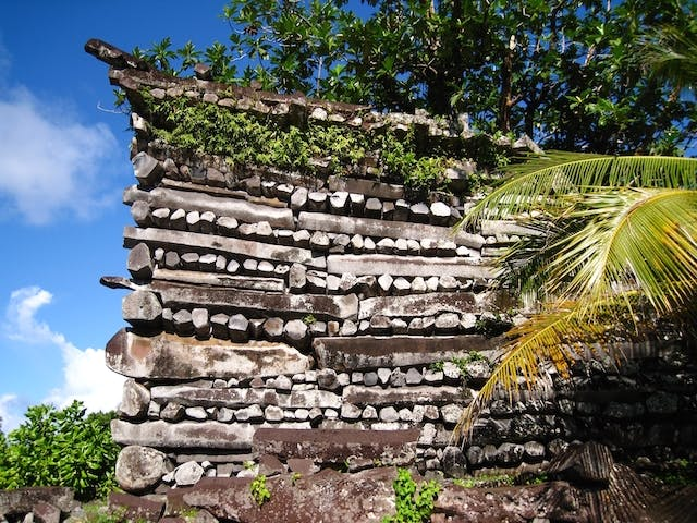 Nan Madol: Ceremonial Center of the Eastern Micronesia: Columnar basalt used in a wall built by in a header-stretcher technique Nandowas Isle