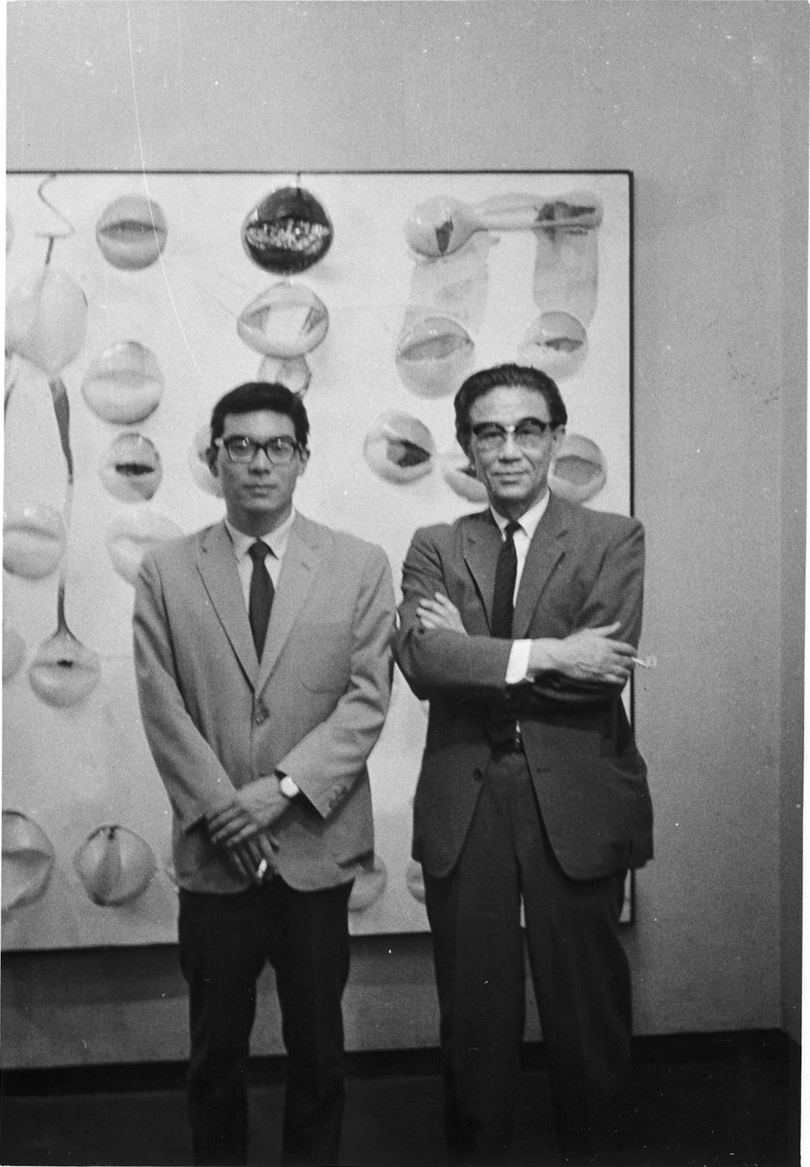 Takesada Matsutani (left) and Jiro Yoshihara (right) at Matsutani's 1963 solo exhibition at the Gutai Pinacoteca, Osaka.