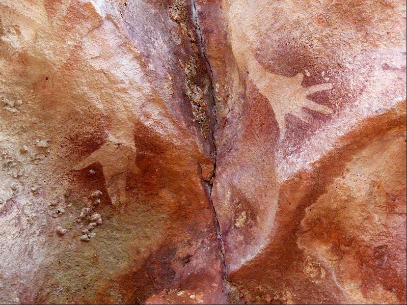 Hand stencils with mutilated little finger at the Djulirri rock art site in the Wellington Range of Arnhem Land, Northern Territory, Australia.