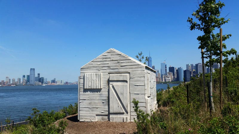 Cabin (2016), Rachel Whiteread, on Discovery Hill, Governors Island.