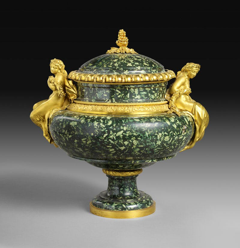 Vase (c. 1775−80), gilt bronze by Pierre Gouthière, green Greek porphyry possibly carved by Augustin Bocciardi or Pierre-Jean-Baptiste Delaplanche. After a design by François-Joseph Bélanger. Musée du Louvre, Paris; photo: RMN-Grand Palais/Art Resource, NY