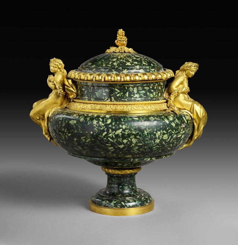 Vase (c. 1775−80), gilt bronze by Pierre Gouthière, green Greek porphyry possibly carved by Augustin Bocciardi or Pierre-Jean-Baptiste Delaplanche. After a design by François-Joseph Bélanger. Musée du Louvre, Paris; photo: RMN-Grand Palais/Art Resource, NY