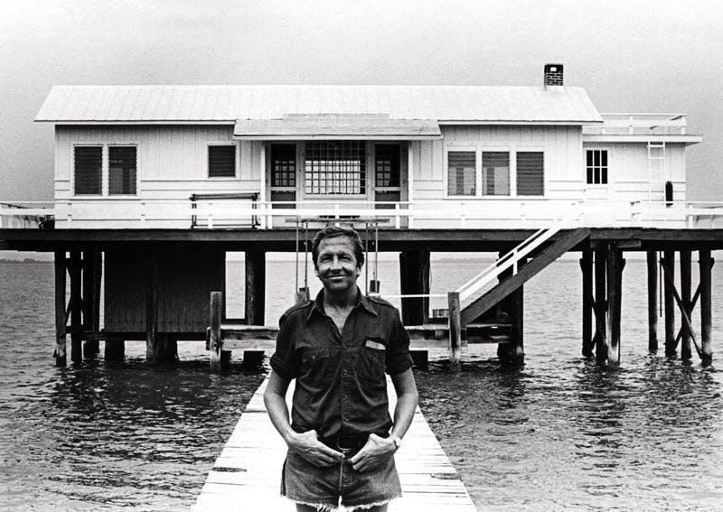 Robert Rauschenberg (1925–2008) in front of the Fish House, Captiva, Florida, 1979. Photo: Terry Van Brunt; courtesy Robert Rauschenberg Foundation