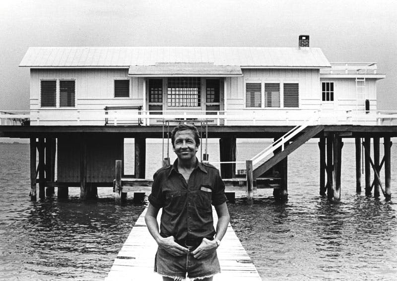 Robert Rauschenberg (1925–2008) in front of the Fish House, Captiva, Florida, 1979. Photo: Terry Van Brunt; courtesy Robert Rauschenberg Foundation